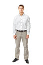 Full length portrait of young man wearing white shirt and light trousers isolated on white background Royalty Free Stock Image