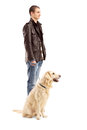 Full length portrait young men standing retriever dog white background Stock Photography