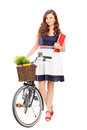 Full length portrait of a young woman with a bicycle isolated on white background Royalty Free Stock Images