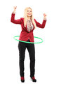 Full length portrait of a young woman dancing with a hula hoop isolated on white background Royalty Free Stock Image
