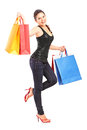 Full length portrait of a young woman holding shopping bags Royalty Free Stock Images