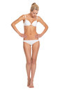 Full length portrait of young woman in lingerie looking on belly isolated white Stock Photo
