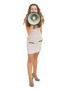 Full length portrait of young woman shouting through megaphone high resolution photo Royalty Free Stock Photography