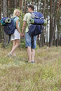 Full length rear view of young backpackers holding hands in countryside Stock Photos