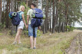Full length rear view of young hiking couple holding hands in countryside Royalty Free Stock Photography