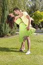 Full length of romantic young couple dancing in park Royalty Free Stock Photo