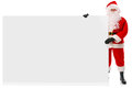 Full length Santa holding large blank sign Royalty Free Stock Images