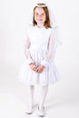 Full length shot young girl smiling her first communion dress veil Stock Photos