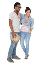 Full length of a smiling cool young couple portrait over white background Stock Photos