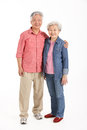 Full Length Studio Shot Of Chinese Senior Couple Stock Photos