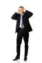 Full length tired man covering ears with hands Royalty Free Stock Photo