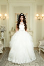 Full length view on beautiful woman posing in a wedding dress. Royalty Free Stock Photo
