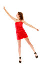 Full length woman in elegant red dress holding imaginary balloons and flying young teen girl raise her hand up invisible isolated Stock Images
