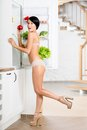 Full length of woman near the opened refrigerator Stockbild
