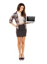 Full length woman showing copyspace on laptop s screen in a studio Royalty Free Stock Image