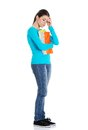 Full length worried woman holding her notes Royalty Free Stock Photos