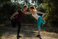Full length of young man and woman exercising on field at farm Royalty Free Stock Photo