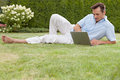 Full length of young man working on laptop in park Royalty Free Stock Photo
