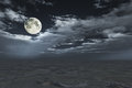 Full moon in cloudscape over sand desert Stock Photo