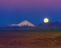 Full moon in the moon valley atacama volcanoes licancabur and juriques west of san pedro de chile cordillera de la sal Stock Photography