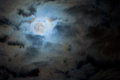 Full moon in night clouds Stock Photos
