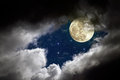 Full moon night cloudy with stars Stock Images