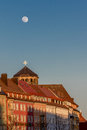 Full moon over bayreuth germany bavaria orthogonal church tower view along the old market place towards the of the old palace Stock Photo