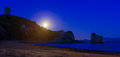 Full moon over the beach Stock Image