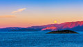 Full moon over Crete at sunset Royalty Free Stock Photo