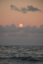 Full moon over ocean and clouds Royalty Free Stock Photo