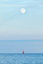 Full moon over ocean Royalty Free Stock Photo