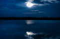 Full moon with reflection in sea. Beautiful nature background. Royalty Free Stock Photo