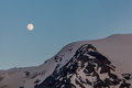 Full moon rising over the mountains in zermatt switzerland Stock Images