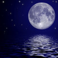 Full moon and stars reflected in the water surface Stock Photos