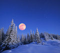 Full moon in winter landscape the mountains at night a and a starry sky carpathians ukraine Stock Photos
