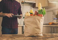 Full paper bag of different food  in the home kitchen Royalty Free Stock Photo