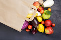 Full paper bag with different vegetables and fruits Royalty Free Stock Photo