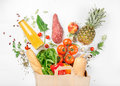 Full paper bag of healthy food on white background Royalty Free Stock Photo