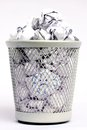 Full paper bin with bad idea silver colored metal of white pieces rolled into balls and a Royalty Free Stock Photography