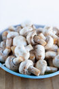Full plate edible mushrooms champignon on the wood board Royalty Free Stock Photos