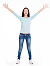 Full portrait of a beautiful young happy woman with raised hands standing on white background Royalty Free Stock Photos