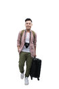 Full portrait of smiling happy man with grey suitcase - isolated Royalty Free Stock Photo