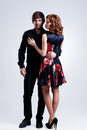 Full portrait of young couple in love posing at studio dressed elegant clothes Royalty Free Stock Photography
