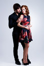 Full portrait of young couple in love posing at studio dressed elegant clothes Royalty Free Stock Photo