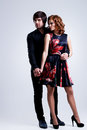 Full portrait of young couple in love posing at studio dressed elegant clothes Royalty Free Stock Images