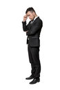 Full portrait of young man in business suit, thinking about something, isolated on a white background Royalty Free Stock Photo