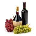 Full red wine bottle and grapes isolated on white background Royalty Free Stock Images