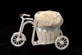 Fulled rice in straw rice bag on wooden tricycle  on   black background Royalty Free Stock Photo