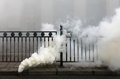 Fuming smoke bomb Royalty Free Stock Photo