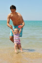 Fun on the beach of father and baby girl Royalty Free Stock Photography